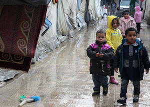 In December 2014, UK aid announced an additional donation of GBP 2.2 million (US$ 3.6 million) funding for the UNRWA cash assistance programme, and for 4,000 winter clothing kits to be distributed to Palestine refugees living in the besieged area of Yarmouk. © UNRWA/Taghrid Mohammad.