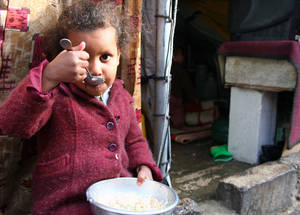 Today, this little girl is able to eat one of her two main meals thanks to generous donors such as UK aid. Support from UNRWA donors makes a difference to the thousands of Palestine refugees facing hardship this winter. Al Rameh School, Jaramana collective shelter, November 2014. © Taghrid Mohammad/UNRWA.