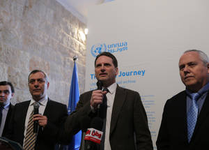 UNRWA Commissioner-General Pierre Krähenbühl (centre) talks to the media at the opening of the exhibition. © UNRWA Photo by Alaa Ghosheh