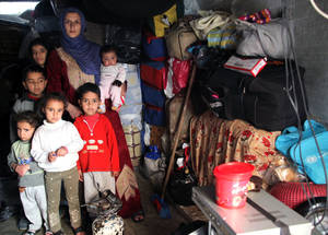 Approximately 280,000 Palestine refugees have been displaced within Syria, losing their homes, assets and savings. Female headed households are among the most vulnerable, including this family in Jaramana Camp, Damascus.  © 2014 UNRWA Photo by Taghrid Mohammad