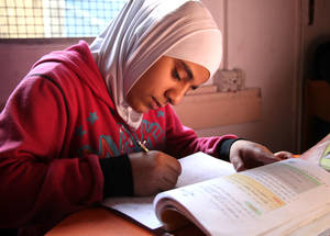 Donor funding has helped UNRWA produce self-learning materials for students unable to access a classroom. Modules in core subjects such as Arabic, mathematics, science and history are supplemented by lessons on the UNRWA satellite television channel. © 2014 UNRWA Photo by Taghrid Mohammad