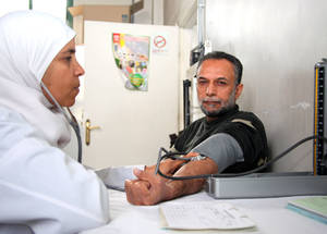 Severe damage to the national healthcare system has increased the pressure on UNRWA health services. Donor support has allowed the Agency to set up 11 addititional health points to meet the needs of the displaced population, including a temporary health point in Yarmouk. UNRWA Alliance Health Centre, Damascus. © 2014 UNRWA Photo by Taghrid Mohammad