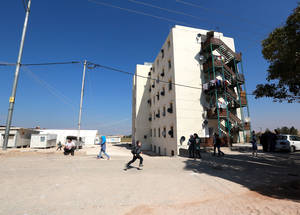 Cyber City, a government facility in Ramtha, Jordan, where 177 vulnerable Palestine refugees from Syria have been residing along with 200 Syrian refugees since 2012. Jordan's official policy of non-admission for Palestine refugees from Syria means that many of the 14,911 refugees recorded with UNRWA live with the daily risk of forced return to Syria. © 2014 UNRWA Photo by Alaa Ghosheh