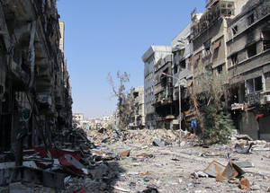 Ongoing and indiscriminate shelling has reduced most of Yarmouk to rubble.  Residents have had no reliable electricity supply since June 2013, when the mains supply was cut. Recent winter storms have deepened the profound suffering of residents, many of whom live without windows or doors. © 2014 UNRWA Photo