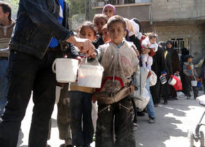 Yarmouk residents now suffer from chronic malnutrition, dehydration and severe vitamin and protein deficiencies. With humanitarian aid, residents have two or more meals a day; without humanitarian aid they are reduced to one or less.  © 2014 UNRWA Photo