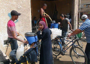Since the first week of September 2014, the mains water supply to Yarmouk has been disrupted, apparently a result of damage to pipes in a contested area inside the neighbourhood. Civilian residents now rely on untreated groundwater and a single well. These water sources are unsafe and insufficient to meet minimum daily water and sanitation needs. © 2014 UNRWA Photo