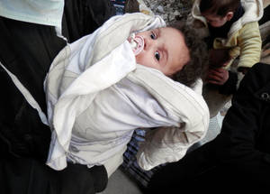Yarmouk's main hospital has no surgical equipment, no surgeons, and just one out-of-date ultrasound machine. Inadequate pre- and post-natal care, as well as malnutrition, puts mothers and new borns at high risk of complications. © 2014 UNRWA Photo