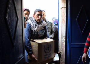 Food prices in Syria have jumped by 275 per cent since the start of the conflict. As a result, many Palestine refugees are now dependent on UNRWA in-kind food assistance to feed their families. © 2015 UNRWA Photo by Ahmad Abu Zeid.