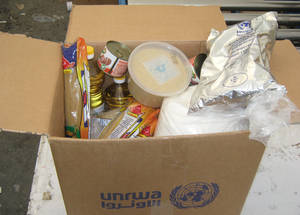 Caption: A typical UNRWA family food parcel provides 700kcal per person per day, for a month, and contains staples such as lentils, rice, cooking oil and halawa. When combined with cash assistance, it ensures that recipients can meet their minimum daily nutritional needs. © 2015 UNRWA Photo