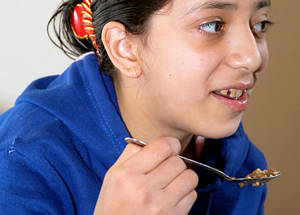 Nisrine's young daughter lost significant weight when she was trapped away from her mother in the besieged area of Yarmouk for eight months, forcing her to survive on grass. UNRWA food packages, made possible by the generous support of the UAE, ensure that each member of her family now has at least 700 kcal per day. Damascus, November 2014. © 2014 UNRWA Photo by Taghrid Mohammad