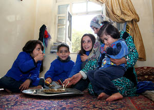 UNRWA food packages, made possible by the generous support and funding of the UAE, allow Nisrine and her family to eat home-cooked food together as a family, an important daily ritual, even in the midst of the conflict. Damascus, November 2014. © 2014 UNRWA Photo by Taghrid Mohammad