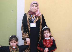 Men and women celebrate International Women's Day in Gaza