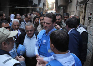 The Faces of Yarmouk: UNRWA Commissioner-General visits Palestine refugees trapped in Syria's conflict zones