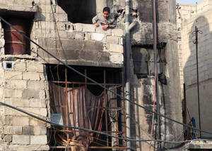 The ongoing hostilities have left over 95 per cent of the 480,000 Palestine refugees remaining in Syria wholly reliant on UNRWA for their minimum daily needs, including food, clothing and shelter.  Qabr Essit, Damascus. © 2014 UNRWA Photo by Taghrid Mohammad.