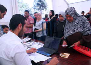 Cash assistance is the lynchpin of the UNRWA humanitarian response in Syria.  In a recent UNRWA evaluation, the majority of respondents stated that cash assistance was the most useful form of humanitarian aid, giving them the ability to respond to their changing needs. © 2014 UNRWA Photo by Taghrid Mohammad.