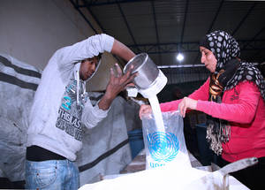 Cash grants, alongside the UNRWA food assistance programme, ensure Palestine refugees meet their minimum nutritional needs. Each food parcel provides 700kcal per person daily, for one month. © 2014 UNRWA Photo by Taghrid Mohammad.