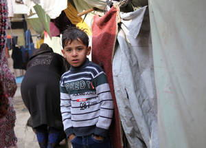 Spring can bring unsettled weather. Because many displaced Palestine refugees in Syria fled their homes with only the clothes on their backs, cash assistance gives them some flexibility to buy clothing in response to the changing seasons. © 2014 UNRWA Photo by Taghrid Mohammad.