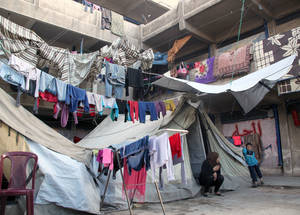 More than 280,000 Palestine refugees have been displaced within Syria as a result of the conflict. Jaramana is one of 16 temporary collective shelters established in UNRWA facilities to accommodate the displaced population. © 2014 UNRWA Photo by Taghrid Mohammad