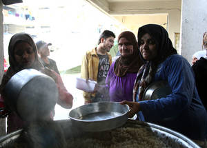 Shelter residents collectively cook two hot meals per day. Jaramana collective shelter, Damascus. © 2014 UNRWA Photo by Taghrid Mohammad