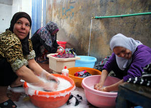 Crowded living conditions in collective shelters mean infectious diseases can spread rapidly. Residents are provided with hygiene kits, including washing powder, soap and baby supplies to help prevent outbreaks. © 2014 UNRWA Photo by Taghrid Mohammad