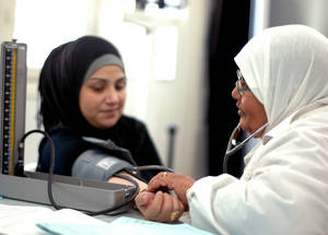 A doctor consults with a patient at the Rukn Eddin Health Centre in Damascus. Rukn Eddin was upgraded from a health point in 2014 to provide additional medical services, including maternal healthcare, laboratory facilities and dentistry. In 2014, UNRWA provided 922,810 consultations. © 2014 UNRWA Photo by Taghrid Mohammad