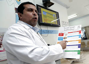 "An UNRWA staff member discusses the 'five keys to safer food' at South Baqa'a health centre in Jordan. Foodborne and waterborne diseases were prevalent in 1950s and 1960s, but rates have decreased with improved awareness about how to store and handle food, and better personal hygiene. ""Education on food safety issues at UNRWA health centres and schools, as well as community outreach activities have become more comprehensive,"" says UNRWA Director of Health Dr. Akihiro Seita. © UNRWA Photo"