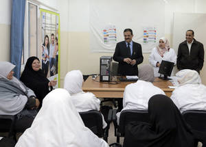UNRWA staff and community members share a laugh during a food safety awareness session at the main Baqa'a health centre in Jordan. © UNRWA Photo