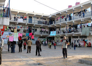 Over 280,000 Palestine refugees in Syria are internally displaced, and many live in crowded conditions. UNRWA runs an early warning system in all collective shelters to mitigate the risk of infectious disease outbreaks. Doumar Collective Shelter, Damascus. © 2014 UNRWA Photo by Taghrid Mohammad