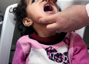 In 2014, UNRWA, working with other partners, vaccinated over 125,000 Palestine refugee children against polio, mumps, measles and rubella. © 2015 UNRWA Photo by Taghrid Mohammad