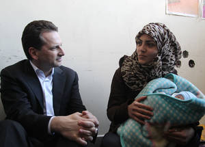 Mr Krähenbühl heard the personal stories of the civilians displaced from Yarmouk. Tiny Jihad Ya'qoub was born on 30 March 2015; he and his mother have received a baby kit and other essential household items from UNRWA. © 2015 UNRWA Photo taken by Taghrid Mohammad