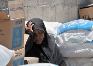 Life continues to be tough for too many people in Gaza. The last conflict took a heavy toll on the livelihoods of Gazan households, whose food insecurity levels can only be expected to further increase. One beneficiary is seen here resting, whilst waiting for her emergency food package. © 2014 UNRWA photo by Shareef Sarhan