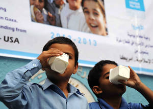 With IRUSA funding, UNRWA contributes to the right of Palestine refugees to live a dignified life by providing access to vital care and specialized support. Here, UNRWA school children in Gaza City drink milk donated by UNRWA before starting morning classes. © 2013 UNRWA photo by Shareef Sarhan