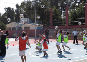 """Sport doesn't only create happiness for children; it encourages them mentally and results in better academic achievement,"" said Hisham Awaad, a teacher and football trainer at Dheisheh school in Bethlehem. Kalandia Training Centre, West Bank. © 2015 UNRWA Photo by Ruba Hafayda"