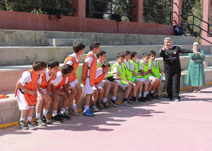 """The main objective of this session is to create happiness among children and teach them good values,"" explained the Technical Sports Coach Trainer of Football Trainers at the Real Madrid Foundation, Miguel Vazquez. Kalandia Training Centre, West Bank. © 2015 UNRWA Photo by Ruba Hafayda"
