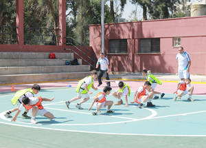 Children partook in team-building activities with the supervision of the teachers trained by the Real Madrid Foundation. Kalandia Training Centre, West Bank. © 2015 UNRWA Photo by Ruba Hafayda