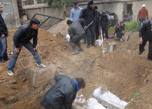 Another photo by Rami al Sayyed, who reported that the dead are being buried in people's yards and gardens. April 2015. © 2015 UNRWA Photo by Rami al Sayyed