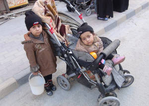 These toddlers were photographed while residents queued outside a charity kitchen in the vicinity of Yarmouk. April 2015. © 2015 UNRWA Photo by Rami al Sayyed