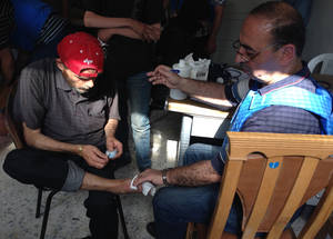 This patient lost three toes while unable to access medication to treat his diabetes in Yarmouk. In April, 26 percent of displaced civilians treated by UNRWA were suffering from non-communicable diseases including hypertension and diabetes. ©UNRWA 9 May 2015.
