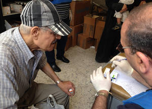 Dispensary services are a key part of UNRWA's medical response. Civilians displaced from Yarmouk have not had reliable access to medication for over two years. ©UNRWA 9 May 2015.
