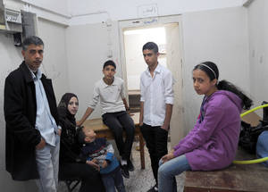 """When we lost our home, it was like we lost our dreams, our existence and our value as human beings,"" recalled 37-year-old refugee Sami Mahmoud Sa'ad, as he stood in the tiny classroom where he has spent eight months together with his wife and five children. The family received a rental subsidy from UNRWA and moved out of the collective centre. ""It will take years to get rid of the bitterness inside me over what happened to my family and my children,"" he said. © 2015 UNRWA Photo by Khalil Adwan"
