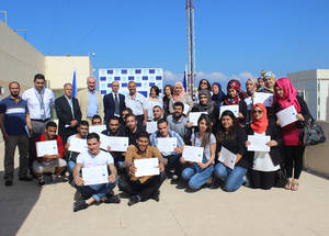 """New knowledge paves the way to a new and better world,"" said Nour Ghadban, one of the training workshop's 35 participants. Participants were awarded Certificates of Appreciation for their successful completion of the programme on 22 June at the UNRWA Lebanon Field Office. © 2015 UNRWA Photo by Mona Hamzeh"