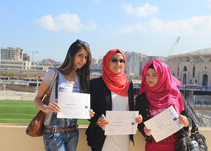 "Participants display their Certificates of Appreciation after receiving them on 22 June. ""The UNRWA vocational training programme aims to equip Palestine youth with useful life skills to help them shape a better future for themselves,"" explained Matthias Schmale, Director of UNRWA Affairs in Lebanon. ""And I thank the EU for supporting UNRWA in giving the opportunity to these young women and men to complement their personal development with essential negotiations skills. © 2015 UNRWA Photo by Mona Hamzeh"