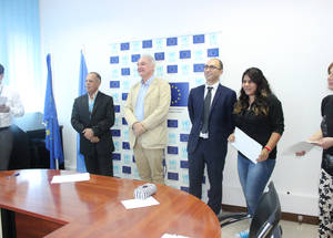 "Matthias Schmale, Director of UNRWA Affairs in Lebanon, and Abel Piqueras Candela, representative of the Delegation of the EU to Lebanon, pose with workshop participants. ""EU supports education as the basis for development and empowerment of individuals and communities,"" said Mr. Piqueras as he addressed the participants. © 2015 UNRWA Photo by Mona Hamzeh"