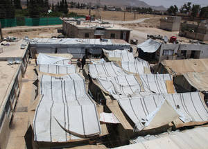 For Palestine refugees, the contraction of the economy has been exacerbated by repeated displacement. More than 280,000 of the 480,000 Palestine refugees remaining in Syria have been displaced at least once. Khan Dunoun collective shelter, Damascus. © 2015 UNRWA Photo by Taghrid Mohammad