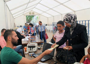 More than 95 per cent of the 480,000 Palestine refugees remaining in Syria rely on UNRWA to meet their most basic needs. Cash assistance is a critical part of the UNRWA humanitarian response. © 2015 UNRWA Photo by Taghrid Mohammad