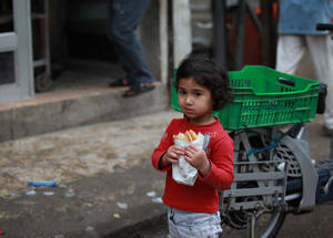 An UNRWA evaluation of the cash assistance programme found that it had a demonstrable impact on the health and well-being of Palestine refugee children. In the majority of households, meals provided as a result of cash assistance were able to ensure minimum calorific intake for children. Homs refugee camp. © 2015 UNRWA Photo by Taghrid Mohammad