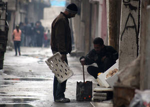 Four years of brutal conflict in Syria have resulted in the near collapse of the economy and have had a devastating effect on Palestine refugees and Syrians alike. Most remaining job opportunities are confined to small-scale businesses in the informal economy. Damascus. © 2014 UNRWA Photo by Taghrid Mohammad