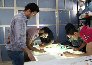 Engaging Youth courses cover professional, trade and creative fields, including graphic and interior design. Young men practice their drafting skills on a light box at the Damascus Training Centre. © 2015 UNRWA Photo by Taghrid Mohammad