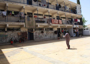 Prior to the crisis, Syria hosted over 560,000 Palestine refugees. Now, more than half have been internally displaced, with a further 80,000 fleeing to neighbouring countries, like Lebanon and Jordan, and to countries in Europe. Increasingly harsh border restrictions mean Palestine refugees in Syria now have few options for refuge. Douma Collective Shelter, Damascus. © 2015 UNRWA Photo by Taghrid Mohammad.