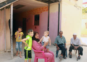When asked about how she spends her holidays, Nour says that after finishing her chores, she chats with the elderly residents who get together to drink coffee and talk about their daily lives. © 2015 UNRWA Photo by Maysoun Mustapha